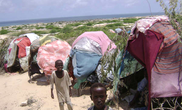 An IDP family, who fled their home in Mogadishu, in a makeshift hut in Burbishaaro, 20 km north of the Somali capital. Part of an IDP camp on the northern outskirts of Mogadishu, September 2007.