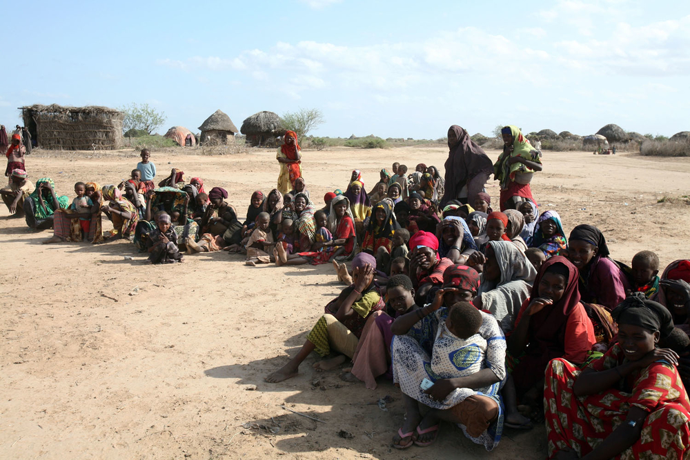 Internally displaced people waiting for food being distributed by the UN World Food Programme in Jowhar, Somalia, September 2007. Thousands of Somalis, who fled the violence in the capital, are facing yet another humanitarian crisis, this time a debilitat