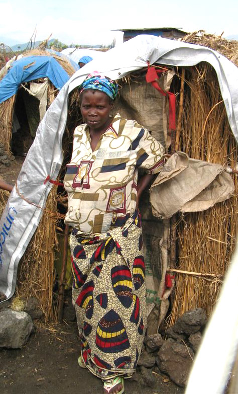 A displaced woman stands in front of her hut at Mugunga Two camp--home to some 20,000 recently displaced Congolese, outside of Goma, North Kivu Province.