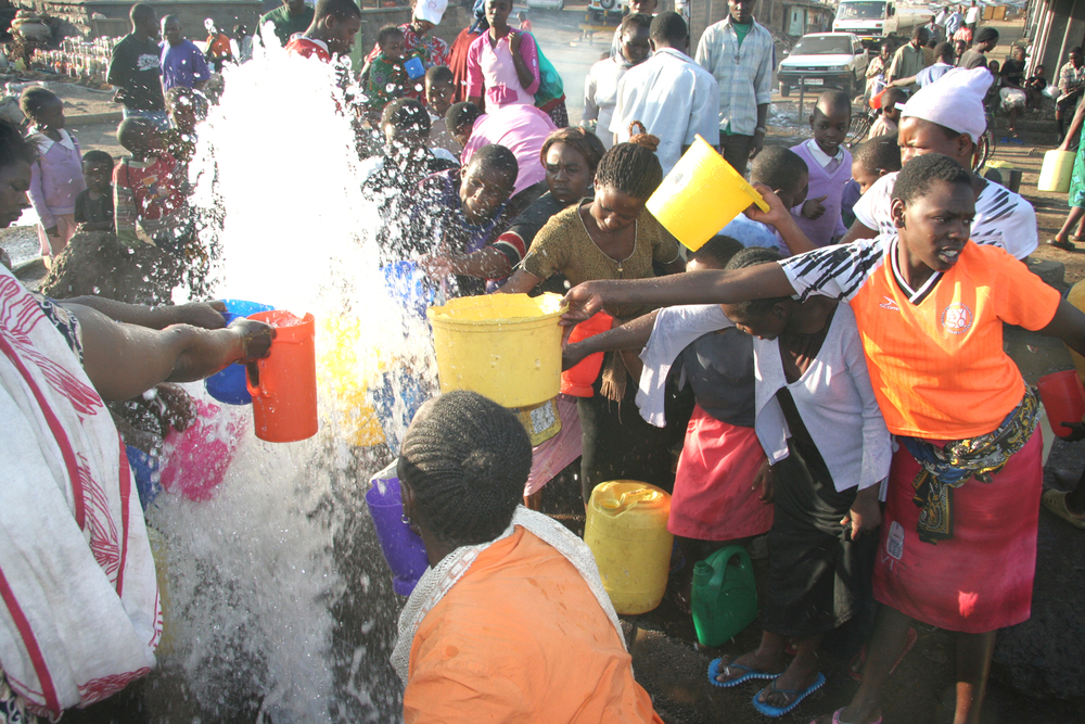 Slum residents collect water in Nairobi, capital of Kenya, November 2007. Mathare slum faces a serious water shortage due to major disconnections from slum inlet pipes.