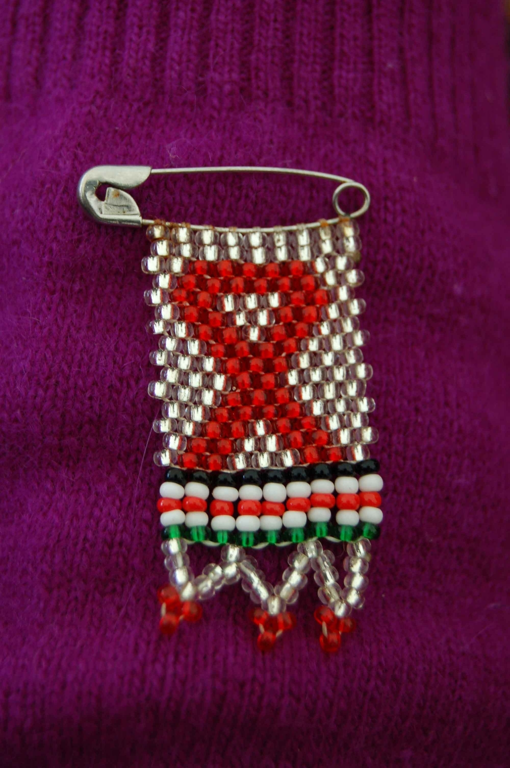 Red ribbon on a pin.