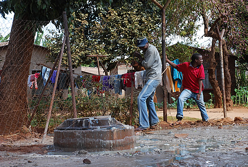 Raw sewage flows outside homes in Kuwadzana 3 township in Harare, Zimbabwe,November 2007. Residents say they now have to lock their children inside their houses to avoid them catching diseases.
