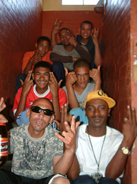 [South Africa] Thug Life gangsters on a stairwell in an apartment block in Kutoon, one of the oldest townships on the Cape Flats and the area in which the gang operates. [Date picture taken: 12/28/2006]