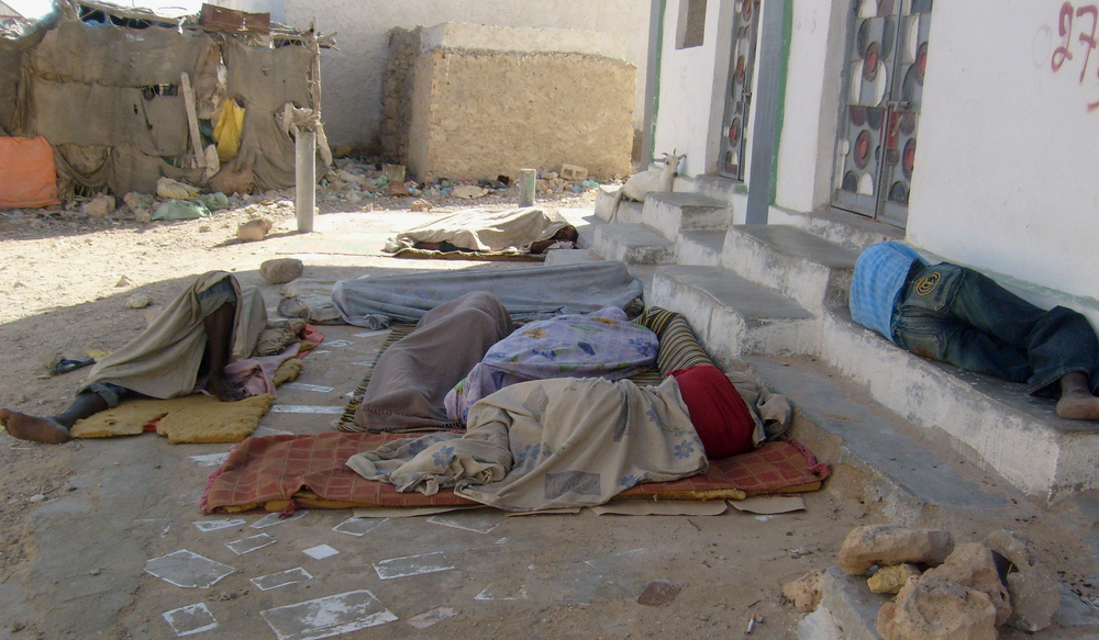 A group of would-be Ethiopian migrants sleep outside a building in Bosasso, capital of Somalia's self-declared autonomous region of Puntland.