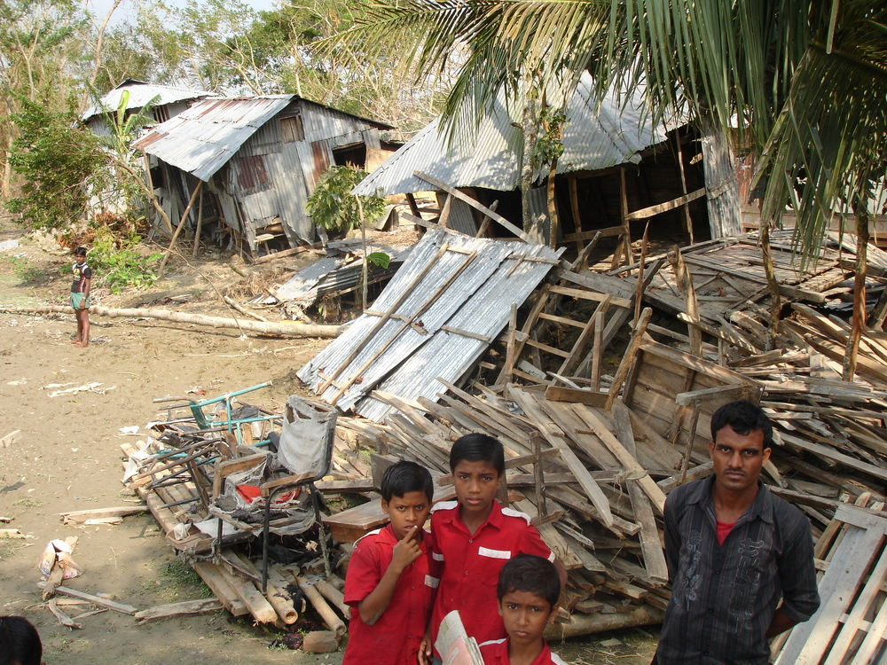 Children stand before the ruins of their primary school in cyclone-hit Patuakhali District southern Bangladesh. Score of schools in the area were badly affected or destroyed when Cyclone Sidr struck the area on 15 November 2007.