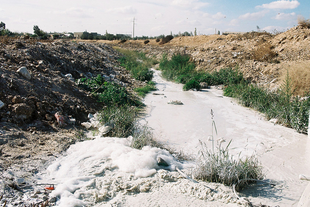 Hebron River polluted inside Israel - when people see a dirty river they throw their garbage.