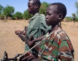 [Sudan] Child soldiers at a military camp in Nyal, southern Sudan, April 2005.  The United Nations Children's Fund has supported the demobilisation of child soldiers throughout southern Sudan since 2000.