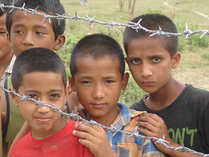 [Nepal] Young Bhutanese boys outside Nepal's Khundunabari refugee camp in southeastern Jhapa district, home to an estimated 13,500 residents. There are an estimated 107,000 Bhutanese refugees in the Himalayan nation. [Date picture taken: 19/04/2007]