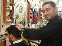 [Yemen] Ahmed Al-Rifaaiy, 30, an Iraqi barber in Sanna, the Yemeni capital, arrived six years ago is satsified with his life, but hopes to one day move to Europe. There are an estimated 70,000 Iraqis living in Yemen, just under 3,000 of whom have formally