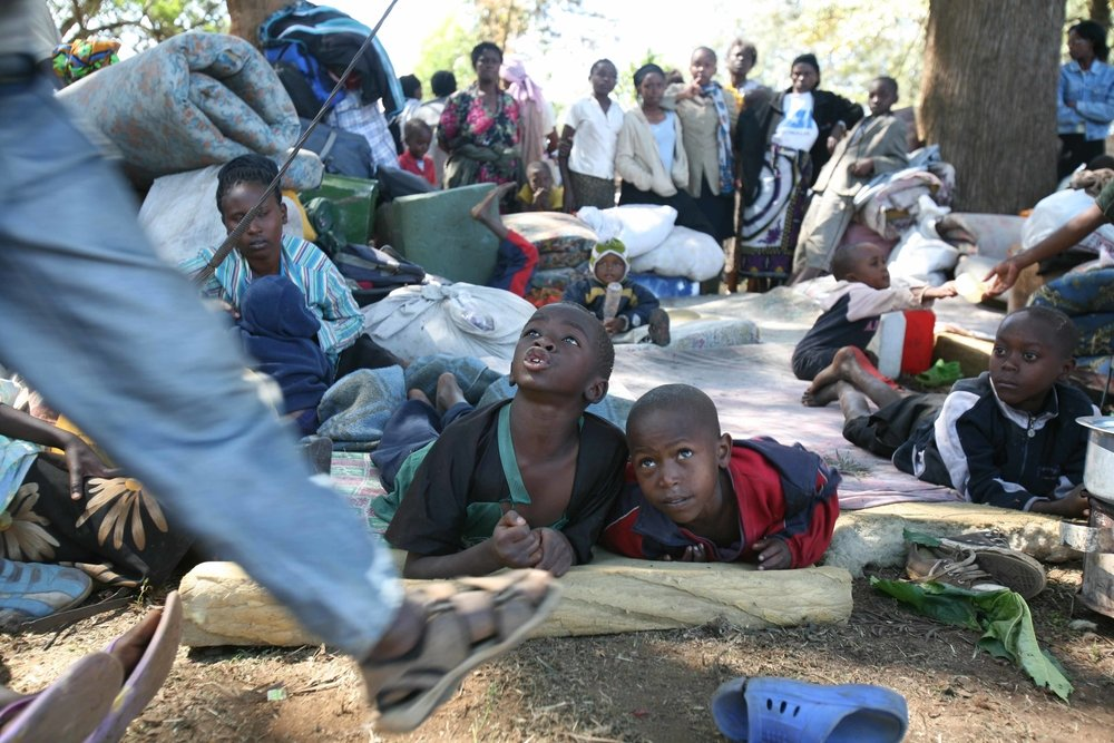 Internally displaced people from Mathare slums take shelter at the Moi Air Force Grounds in Nairobi, Kenya, January 2008. Agencies and NGOs working in the country estimate that up to half a million people have been made homeless by the violence.