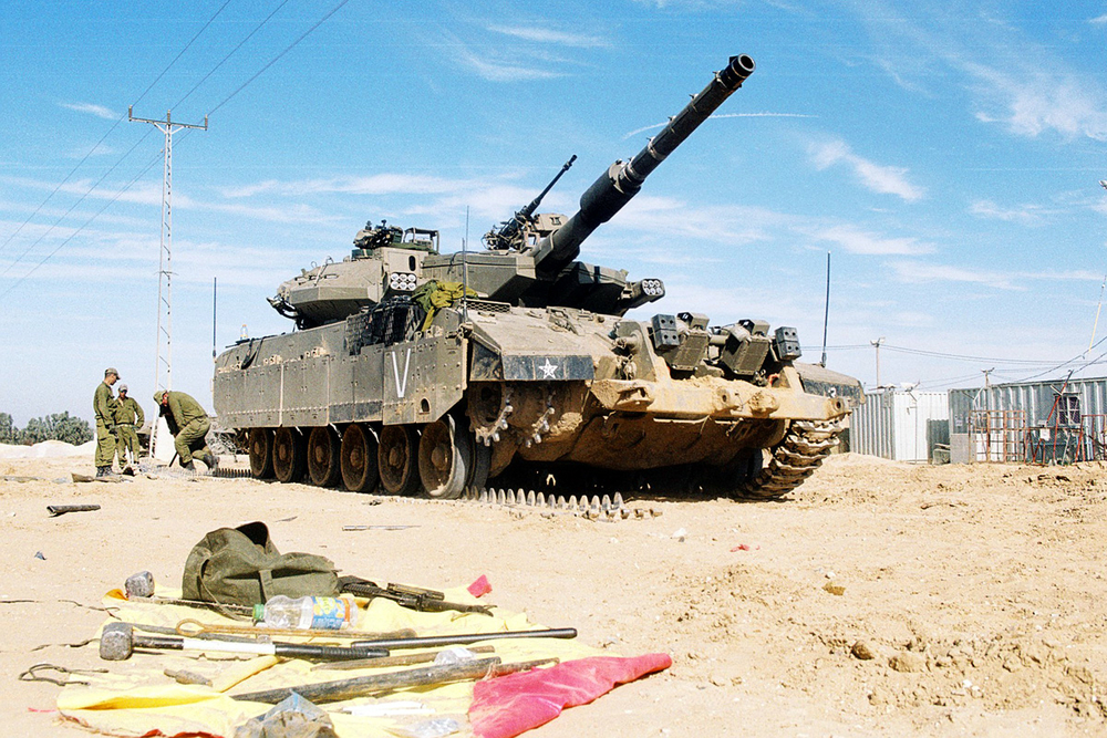 Israeli troops lining up outside Gaza last week, preparing equipment.