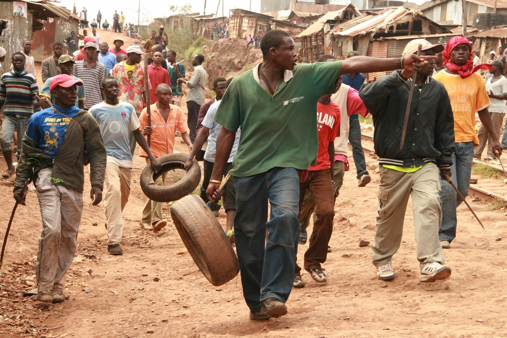 Youths in Kibera slums carry crude weapons ready to fight youths from the rival side, Nairobi, Kenya January 2008. Three people were killed as a result of the confrontation before police could calm the situation.
