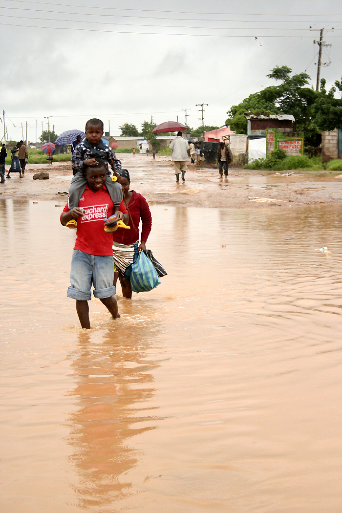 Lusaka residents have had to wade through the water, after a continuous heavy downpour over the last two weeks left most parts of the Zambian capital city flooded.