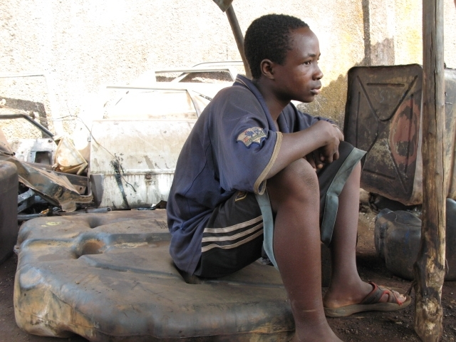 Mamadou Aliou Barry, 13, was given away by his family.  He says he was forced to break rocks by his 'tutor' for no pay.
