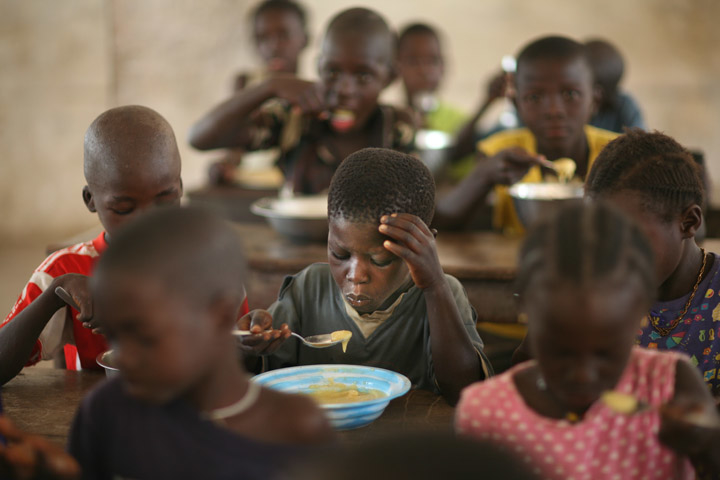 Pupils eat food donated by WFP in a classroom in Eva Orango school in Orango Island of Bijago Archipelago in Guinea-Bissau Feburary 2008. According to World Food Program (WFP) intellectual levels rise when children are fed properly.