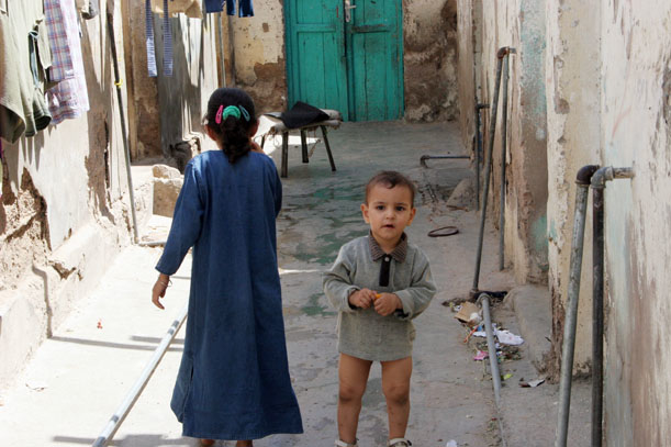 Children play near their home in an impovershed town in the port city of Aqaba. The sewage network in this area is at the brink of collapsing, according to residents.