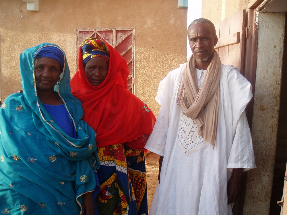 Members of the village committee which manages the grain bank in Sayene village, in southern Mauritania, outside the grain store.