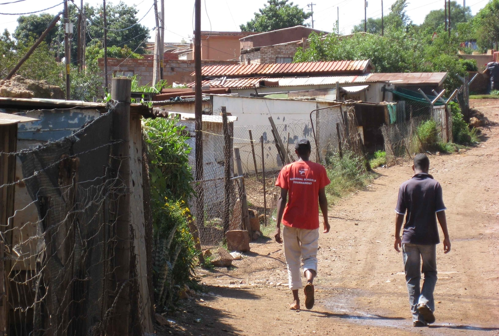 Two boys walk in the informal settlement of Brazzaville west of Pretoria.