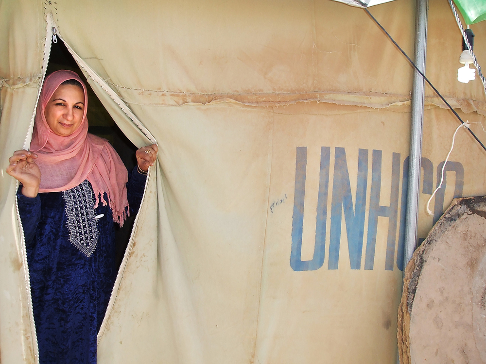 Ibrahim's mother in her tent at al-Tanf where nearly 700 Palestinians from Iraq remain trapped between the Iraq and Syria border.