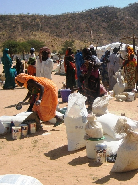 Displaced women at Koloma in southeastern Chad gathering to receive food aid for their families.