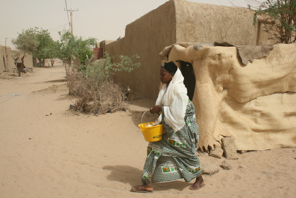 Woman walking in the street in a town in northern Mali. Women do not have equality with men under Malian law.