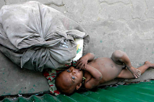 This unregistered baby born on the streets has little hope of living a normal human life. The government is currently pushing for all citizens to be issued birth certificates by 2009.
