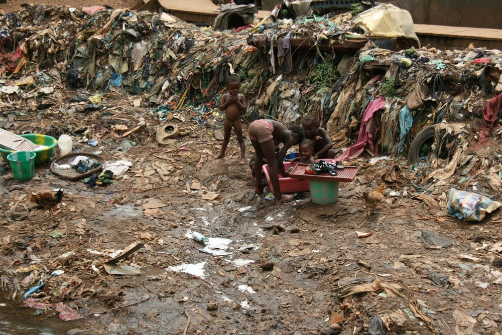 The Kroo Bay slum in central Freetown, home to 6,000 of the poorest people in the poorest country in the world. When it rains, the shelters flood with waste water and rubbish.