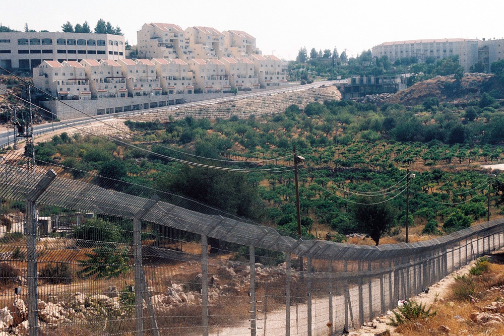 The fence surrounds the Palestinians and not the settlements.