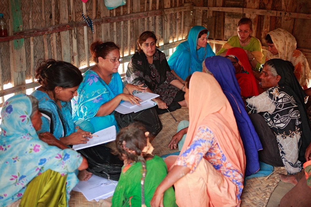 Women at Pirthi Goth answer the McRAM survey team's questions.