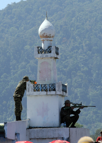 MILF snipers take up positions on a minaret in a MILF camp in Lanao del Norte Province, Mindanao Island.