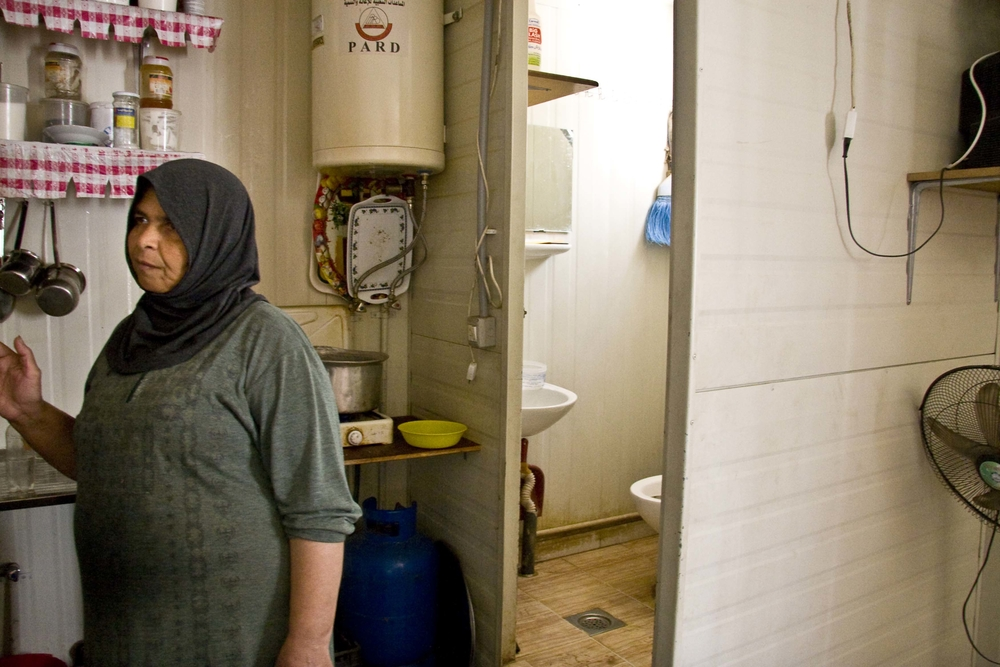 A toilet and kitchen area are contained within the 18-square-metre units and residents say water from the units above leaks through the ceilings, while sewage running under the floorboards is a sanitary hazard.