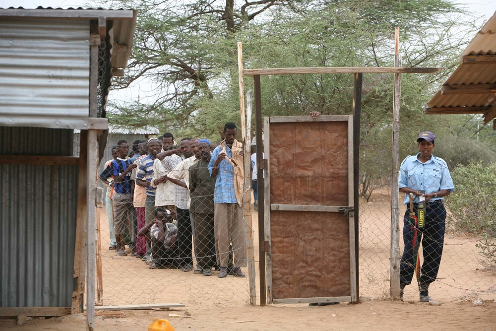 Somali refugees queue up outside the gate of the UNHCR compound prior to admission to Dadaab refugee camp, Kenya, October 2008.