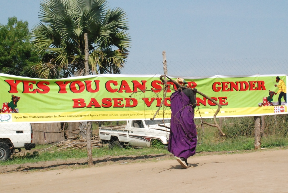 A southern Sudanese woman from the town of Bor looks at banner calling for an end to gender based violence during a November 2008 demonstration
