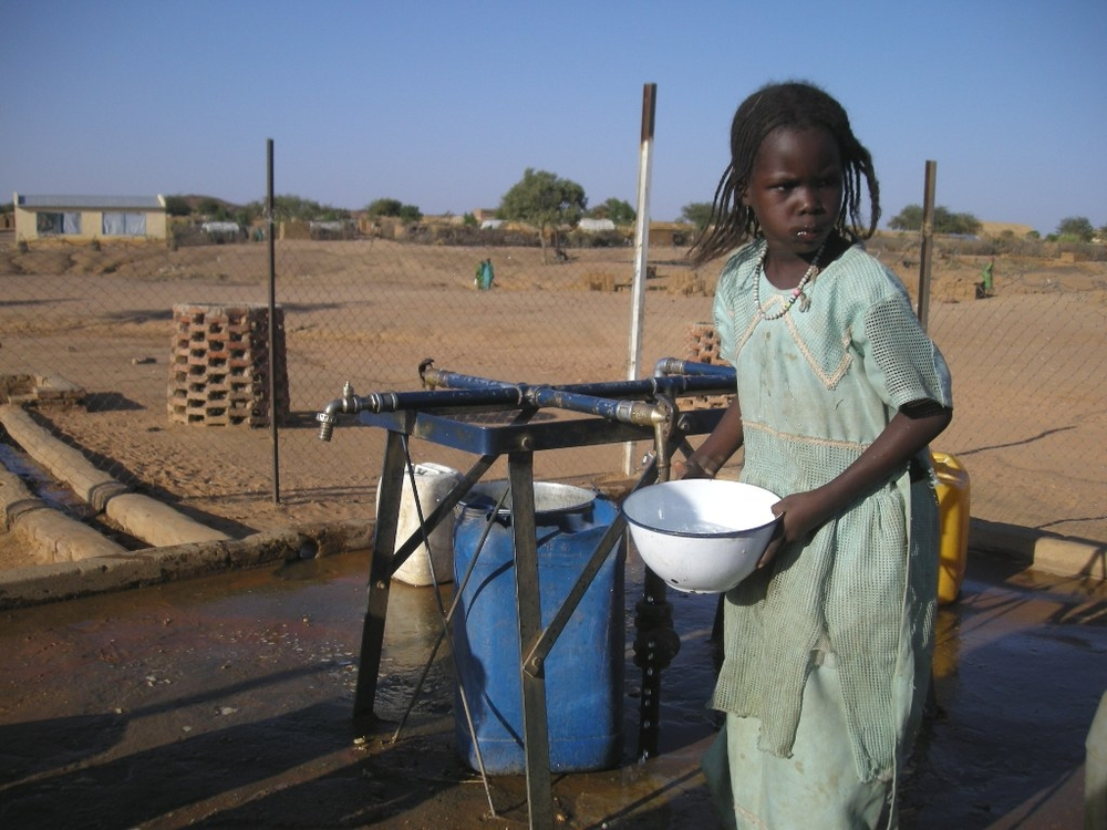 A young girl getting water at the Farchana refugee camp in eastern Chad