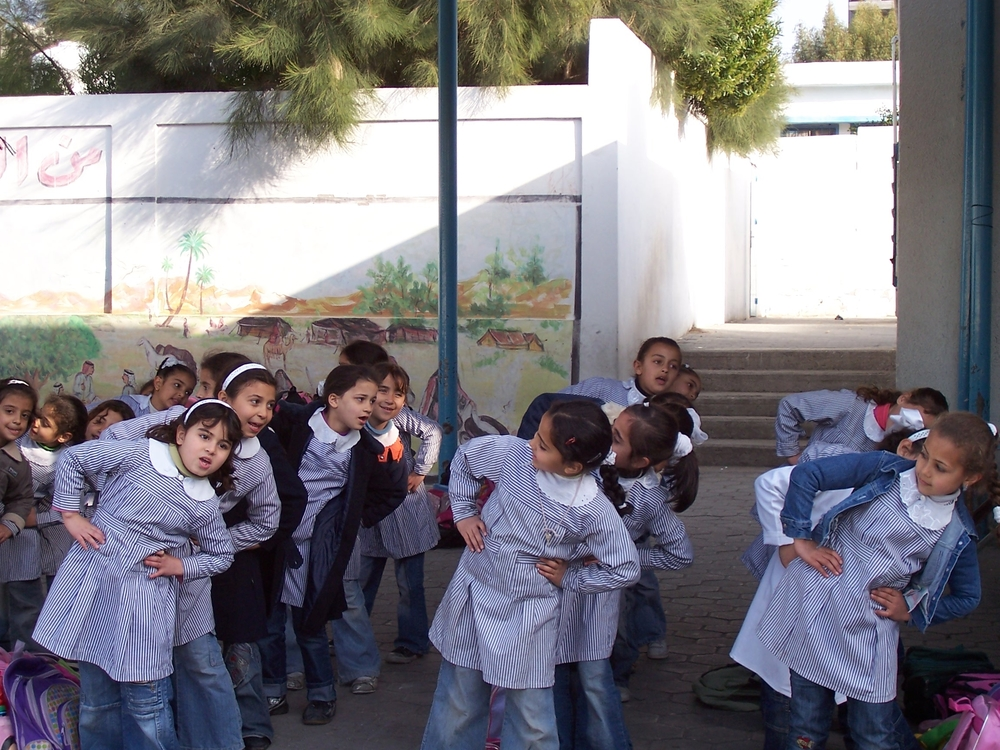 "First graders at Asma Co-ed Eementary School ""A&B"" in Gaza City, run by UNRWA, participating in stress-relieving games and activities to recover from psychosocial trauma incurred during the war"