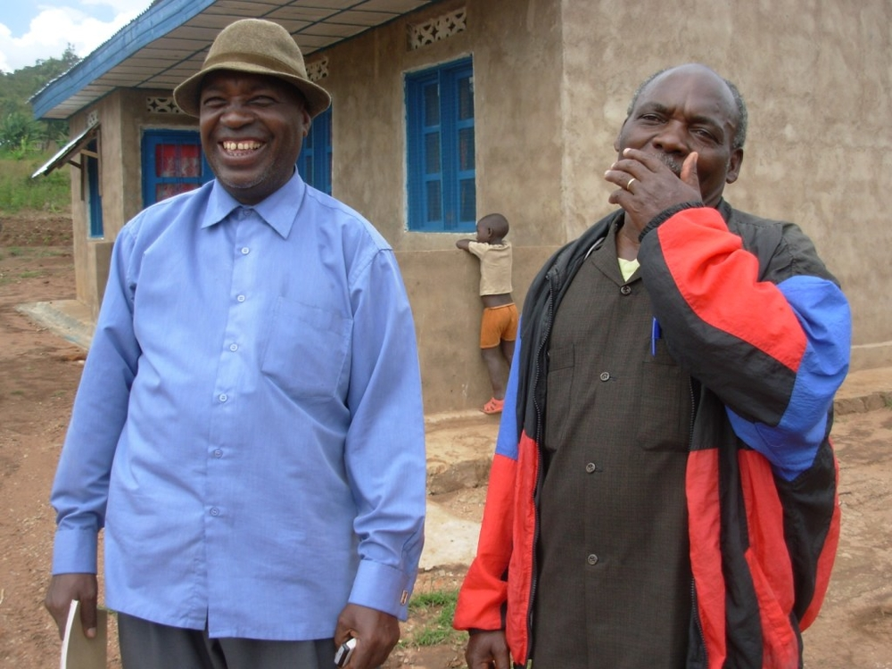 Jonas Saya and former Tutsi neighbor André Kareke, who decided to share a piece of land as a way to solve dispute over its ownership