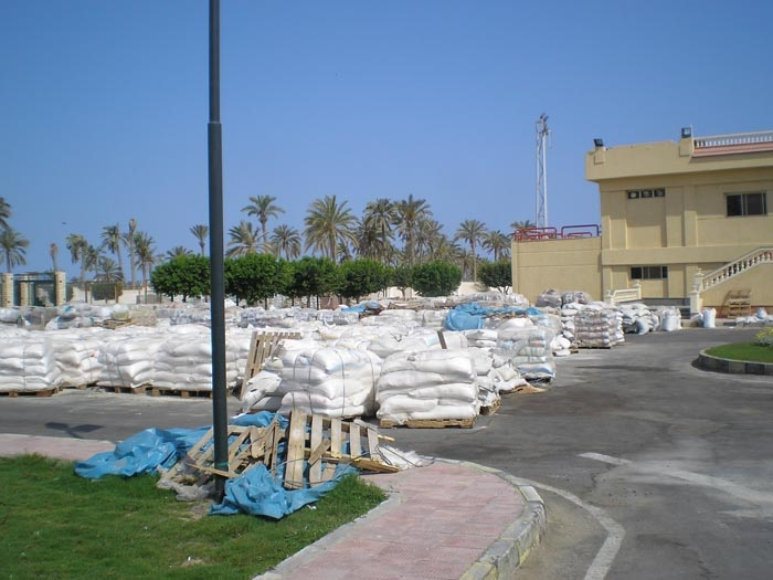 Sacks of Gaza aid remain exposed in al-Arish stadium