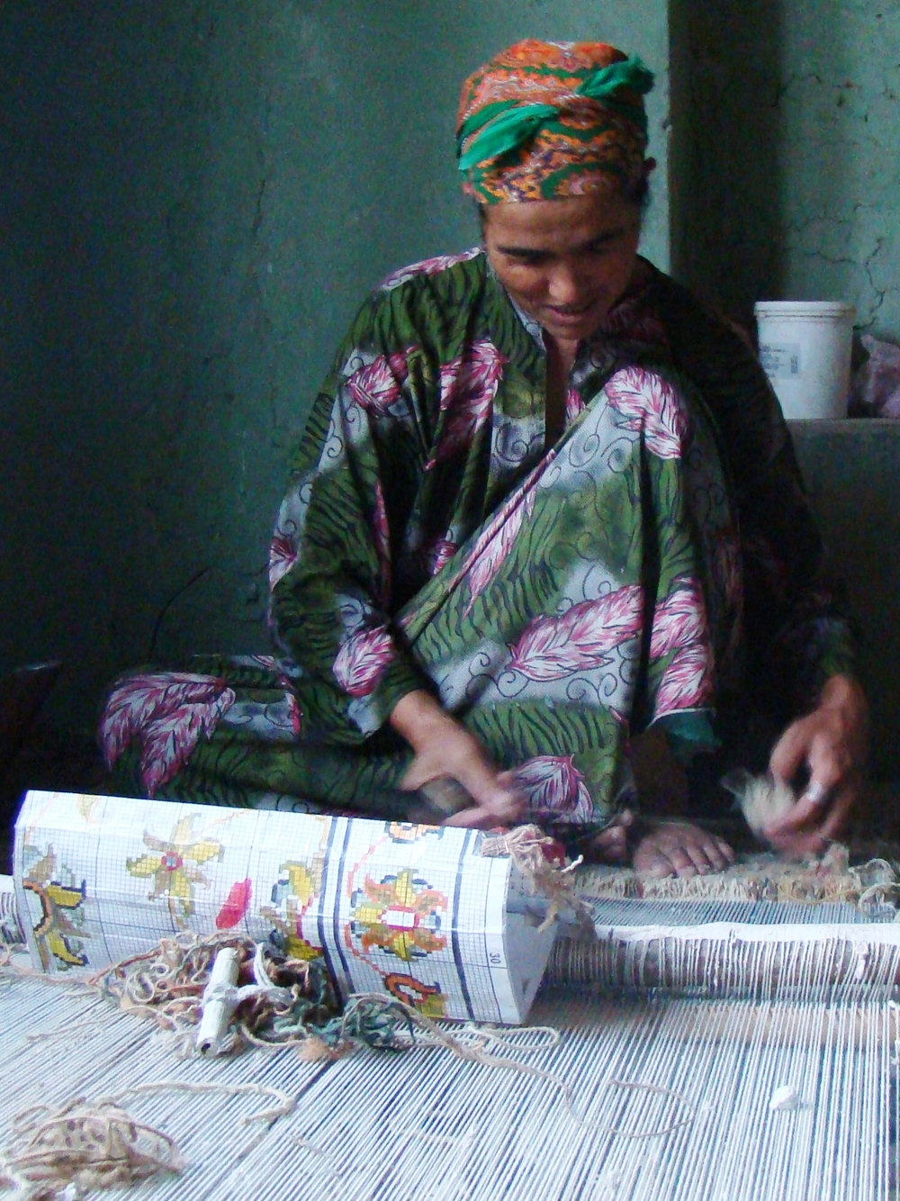 Some women involved in carpet weaving use opium as painkiller