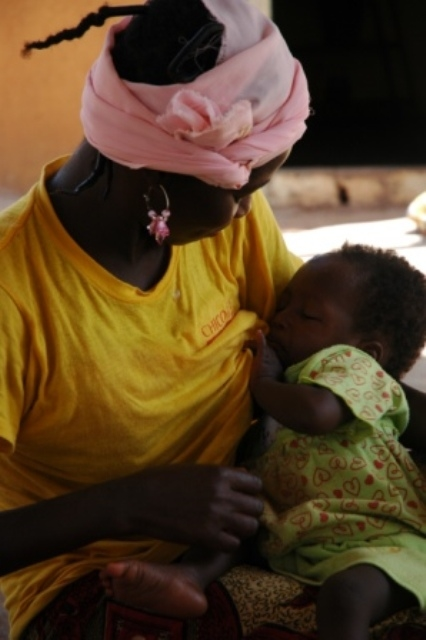Woman breastfeeding in Burkina Faso