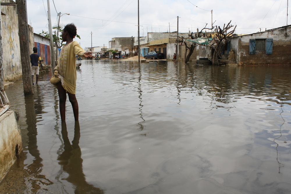 A girl walks along a flooded street in the Pikine department of Senegal's capital Dakar. August 2009