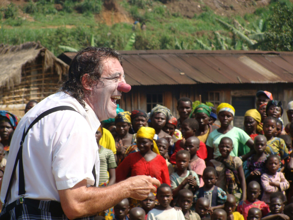 A member of the team from Clowns Without Borders entertains children in an IDP camp in eastern DRC