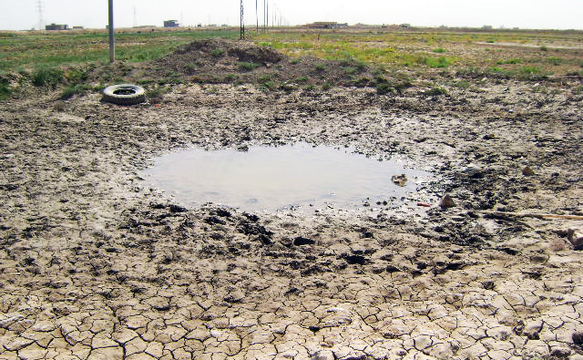 A dry pond in drought-afflicted al-Muthanna Governorate