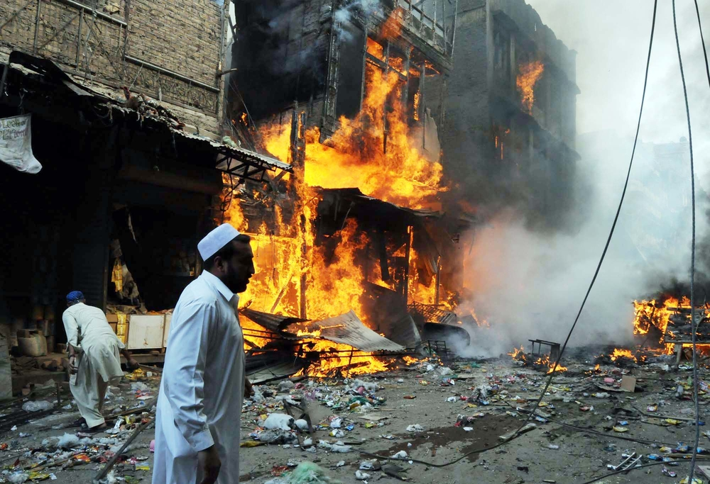 The terrible aftermath of a huge bomb blast in the western Pakistani city of Peshawar on 29 October which left 117 people dead