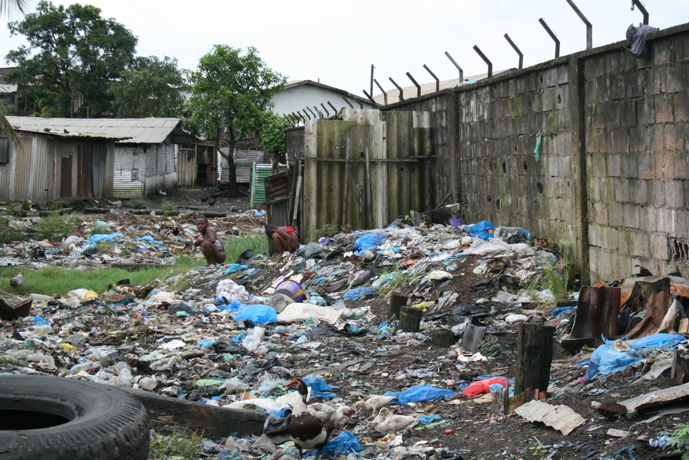Children openly defecate in Sawmill, a neighbourhood of Monrovia