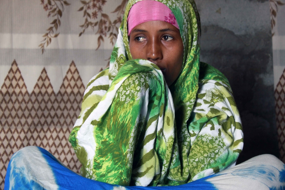 Zeband sitting in her home that she shares with two other Somali girls at Kharaz camp