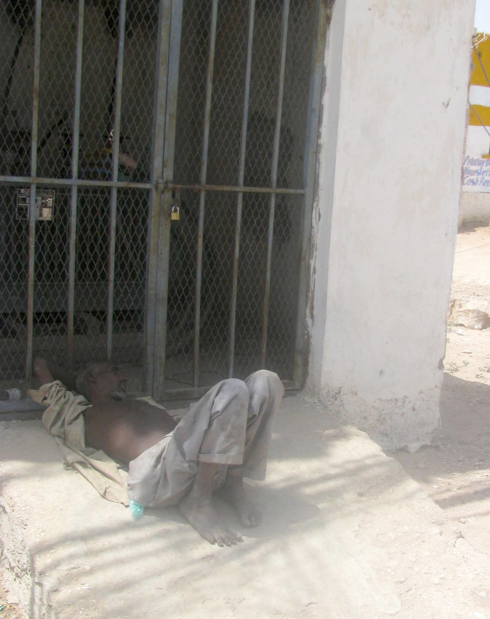 A mentally handicapped man lies on the ground near an electricity poll in Hargeisa: Health officials have expressed concern over the rise in mental health challenges in the region