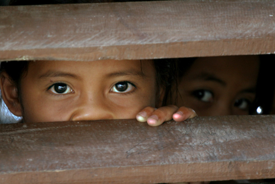 Children peek out of the window of a classroom converted into an IDP evacuation center in the southern province of Maguindanao, Mindanao