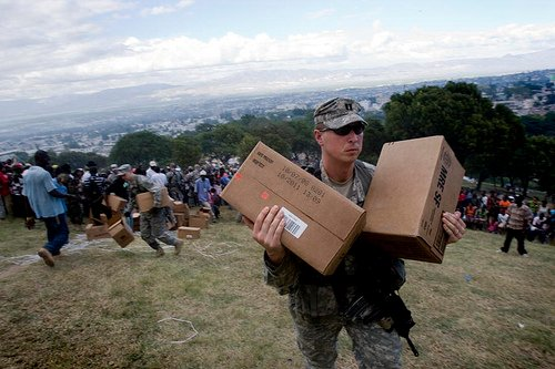 U.S. Marines protect food distributions from possible looting at the golf course in Port-au-Prince, Haiti
