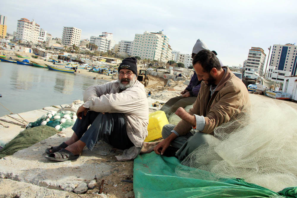 Sami al-Qouqa, a 30-year-old former fisherman from al-Shati refugee camp in northern Gaza, lost his left hand when his fishing boat came under fire from an Israeli gunboat on 12 March 2007. He sits with his fishermen friends in Gaza port
