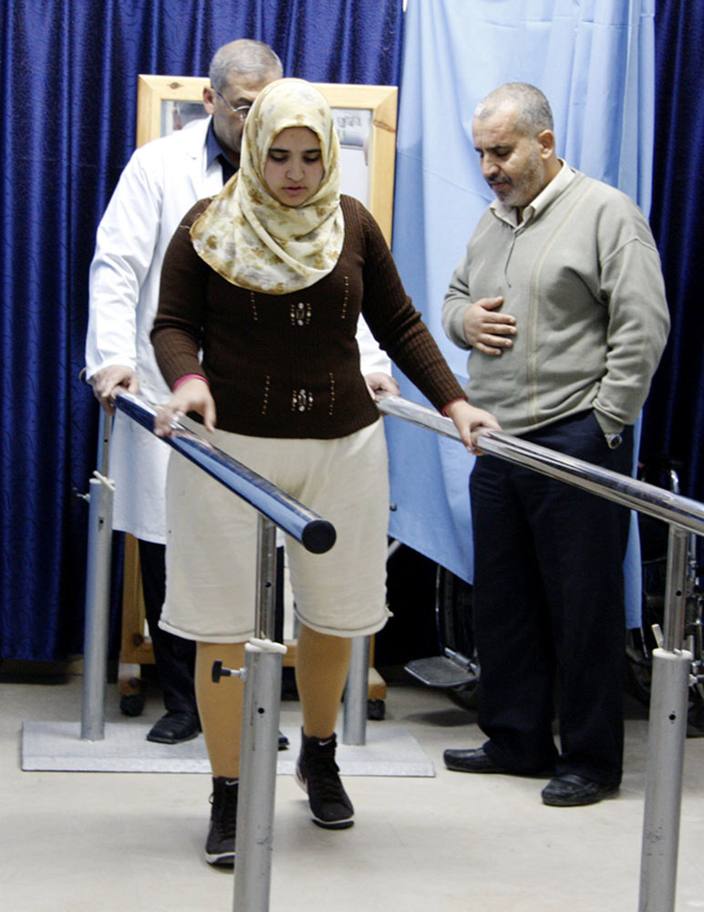 Jamila al-Habbash, 15, lost both her legs in a missile strike by an unmanned Israeli drone as she played on the roof of her home in eastern Gaza. She receives training to wear her artificial legs at the Artificial Limb and Polio Centre in Gaza